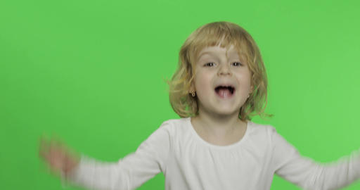 Happy little blonde girl in white t-shirt. Cute blonde child. Clapping in hands Live Action