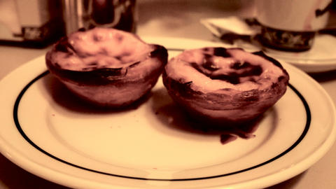 dish with the famous pasteis de nata, typical dessert of Lisbon, Portugal Footage