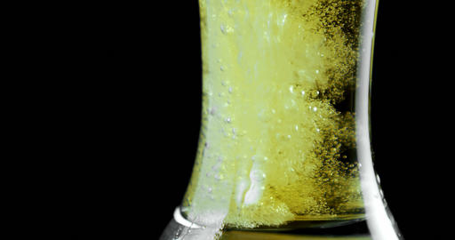 Beer poured in glass against black background 4k Live Action