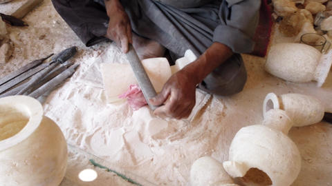 Man Shapes an Alabaster Stone Vase Using a File Footage