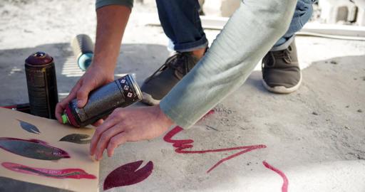 Graffiti artist spraying spray paint on cardboard 4k Live Action