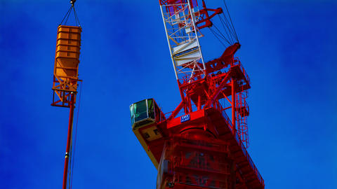 A time lapse of moving cranes at the under construction in Tokyo closeup ビデオ