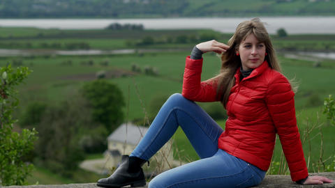 Young woman relaxes in the wonderful green nature of Ireland Footage