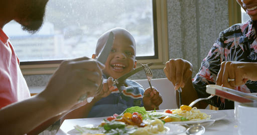 Family having food at dining table in a comfortable home 4k Live Action