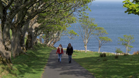 Two young women on their journey along the causeway coast in Northern Ireland Live Action