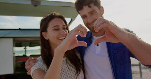 Couple forming heart shape with hands 4k Live Action