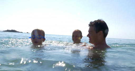 Family fun in water on hot summer day Footage