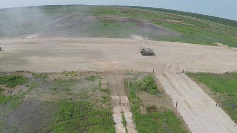 Aerial shot of military vehicles on shooting-ground Footage