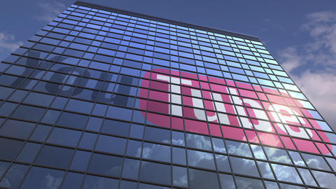 Logo of YOUTUBE on a media facade with reflecting cloudy sky, editorial Footage