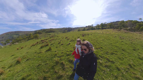Two girls have fun with a 360 degree camera Footage