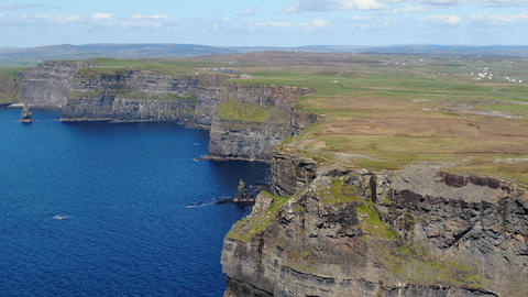 Cliffs of Moher in Ireland at the Atlantic Ocean - aerial drone footage Live Action