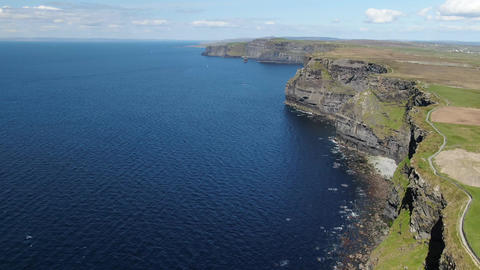 Aerial view over the famous Cliffs of Moher in Ireland Live Action