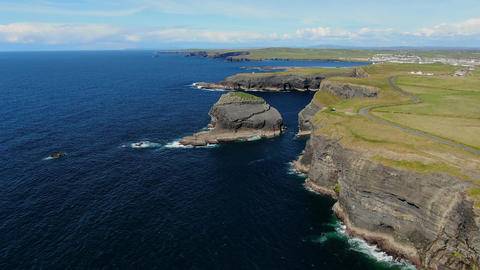 Cliffs of Kilkee at the Atlantic coast of Ireland - aerial view Live Action