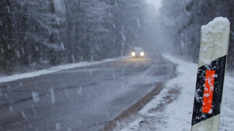 Road in bad weather conditions in winter, danger of bad weather Live Action