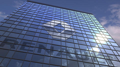 Logo of RENAULT on a media facade with reflecting cloudy sky, editorial Footage
