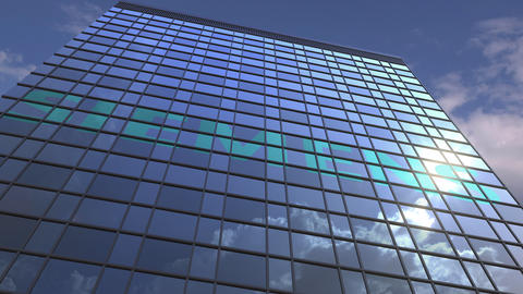 Logo of SIEMENS on a media facade with reflecting cloudy sky, editorial Footage