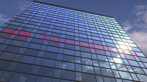Logo of SANTANDER on a media facade with reflecting cloudy sky, editorial Footage