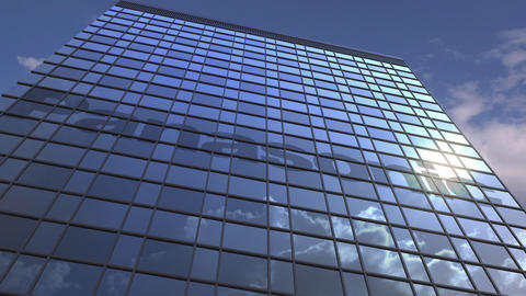 Logo of PANASONIC on a media facade with reflecting cloudy sky, editorial Live Action