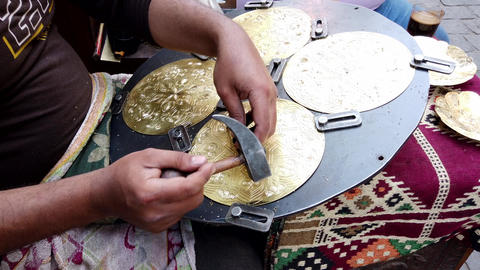 Cairo, Egypt - 2019-05-03 - Artisan Carves Intricate Design in Brass Plate Live Action