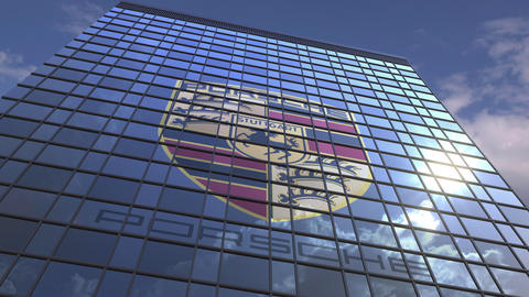 Logo of PORSCHE on a media facade with reflecting cloudy sky, editorial Live Action