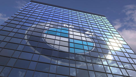 Logo of BMW on a media facade with reflecting cloudy sky, editorial animation Live Action