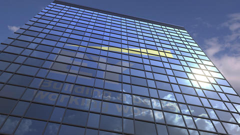 Logo of EY on a media facade with reflecting cloudy sky, editorial animation Footage