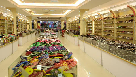 All type of colorful slippers and shoe display Racks with wall shelves boots and sneakers, designer Live Action