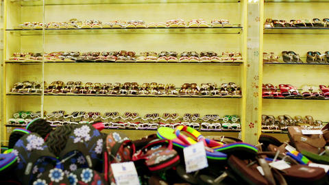 Colorful display of traditional leather slippers for sale, a large selection of home shoes for sale Live Action