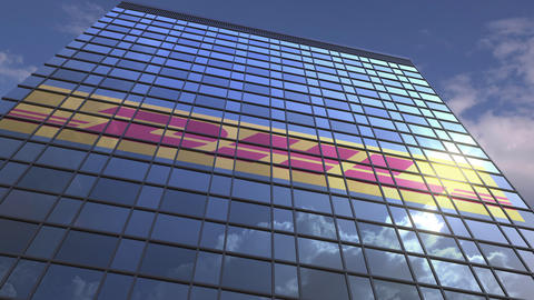 Logo of DHL on a media facade with reflecting cloudy sky, editorial animation Live Action