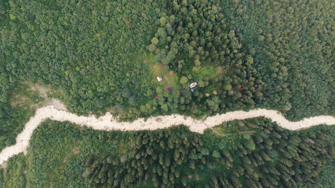 4k - dirt road to the valley among the trees in the Caucasus, aerial action Live Action