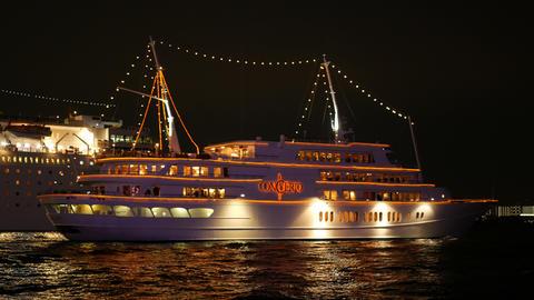 Cruise ship sailing from Kobe port at night GIF
