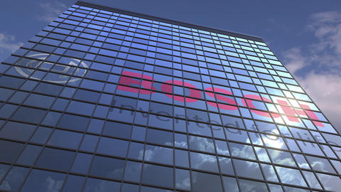 BOSCH logo on modern building reflecting sky and clouds, editorial animation Live Action