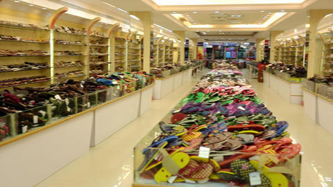 Footwear outlet at mall in India for sneakers, designer classic shoes Live Action