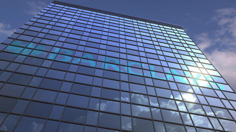 Logo of BARCLAYS on a media facade with reflecting cloudy sky, editorial Footage