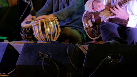 Two men playing traditional Indian tabla drums and sitar Live Action