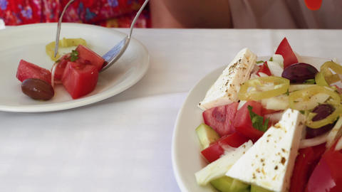 Greek salad closeup served on white dish Footage