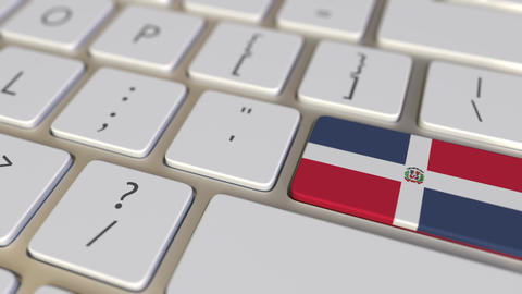 Key with flag of the Dominican Republic on the computer keyboard switches to key Live Action