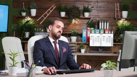 Zoom in shot of businessman working alone in office with modern design Footage