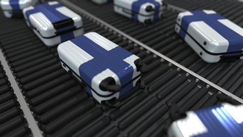 Many travel suitcases featuring flag of Finland. Finnish tourism conceptual Footage