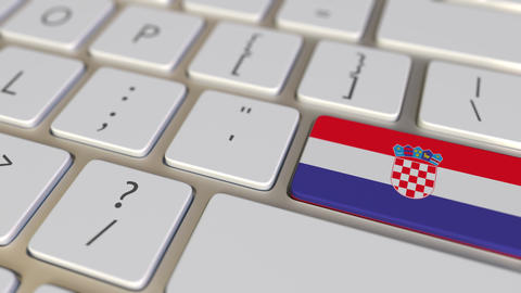 Key with flag of Croatia on the computer keyboard switches to key with flag of Live Action