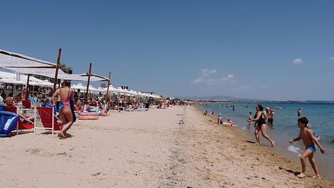 Greek Mediterranean beach bar with crowd in Chalkidiki hyper lapse Live Action