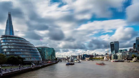 London Skyscrapers over the Thames. Sunshine. White clouds are visible on the Footage