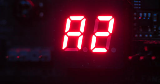 Close-up shot LED digital number status indicator on electronic printed circuit board with dark and Live Action