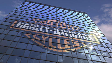 Logo of HARLEY-DAVIDSON on a media facade with reflecting cloudy sky, editorial Footage