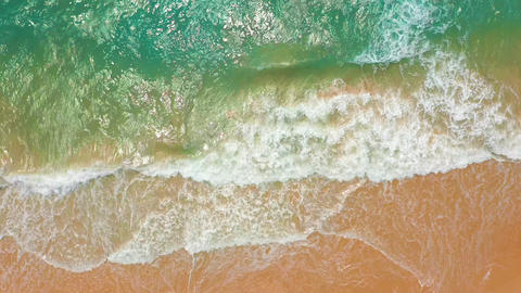 Aerial view. Big Waves rolling on coast ocean, breaking waves, shoreline Footage
