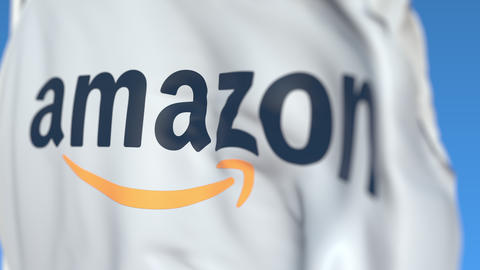 Waving flag with Amazon logo, close-up. Editorial loopable 3D animation Live Action