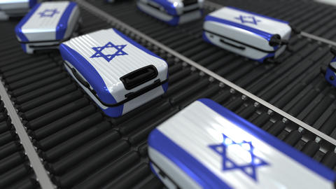 Many travel suitcases featuring flag of Israel. Israeli tourism conceptual Footage