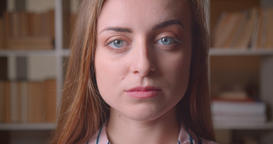Closeup portrait of young pretty caucasian female student looking at camera in Footage