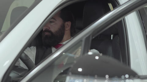 Portrait attractive confident bearded businessman sits in the vehicle and Footage