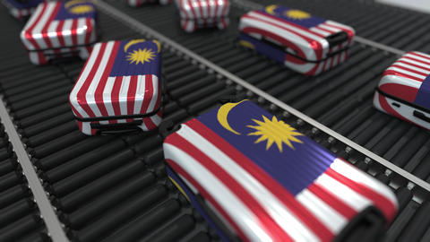 Many travel suitcases featuring flag of Malaysia. Malaysian tourism conceptual Footage